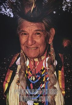 Cherokee Indian Clothing   Smiling old Cherokee Indian in traditional clothes stock photo