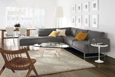 Exquisite living room with a large grey sectional sofa Timeless Sculptural Decor Inspirations By Isamu Noguchi