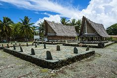 Traditional house with stone money in front, Island of Yap, Federated States of…