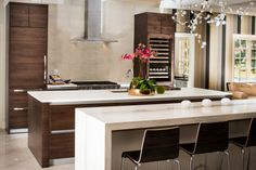 Stunning contemporary kitchen. Matched-grain walnut, with two spacious islands and continuous-pull hardware throughout. www.alkl.com