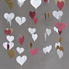 Hanging paper and glitter hearts.