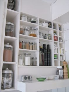 cubby shelves - great use of vertical space in a small kitchen. White, Glass and Silver
