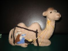 Needle felted camel with nativity (front).