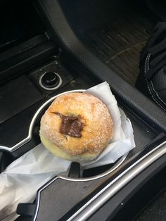#mycupholder is holding my #sweetsreams. An Italian style donut filled to the gills with oozing Nutella.