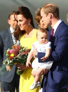 Is it nap time yet? A weary looking Prince George looks into the distance as his parents greet awaiting well-wishers.