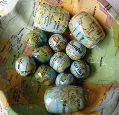Maps decoupaged on wooden beads. These would be sweet if you used a map of special place and then used the bead as a toggle on your purse or part of your key chain.
