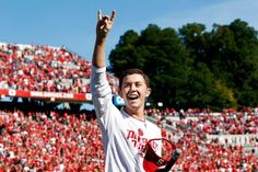 Scotty McCreery gives the Wolfpack sign after singing the National Anthem before N. State's game against Central Michigan on Oct. 2011 at Carter-Finley Stadium in Raleigh. Nc State University, Singing The National Anthem, Central Michigan, Scotty Mccreery, American Idol, New England Patriots, Entertaining, Sign, Game