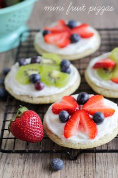 Mini Fruit Pizzas - one of the prettiest and yummiest treats you'll ever make. A sugar cookie base with a cream cheese frosting, topped with fruit!