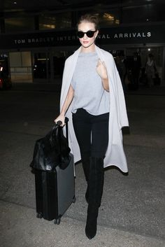 Want to make your lazy-girl travel ensemble seem somewhat elevated? Drape a long sweater over your shoulders, which will add a chic, fashion-girl update that's Rosie Huntington-Whiteley approved.
