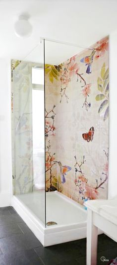 Butterflies and flower on the shower tile