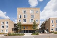 """Key Worker Housing is characterised by its varied material finishes, including oak cladding and yellow bricks, which were chosen by Mecanoo to reflect the """"layering of architectural inventions over the centuries"""" throughout the English city."""