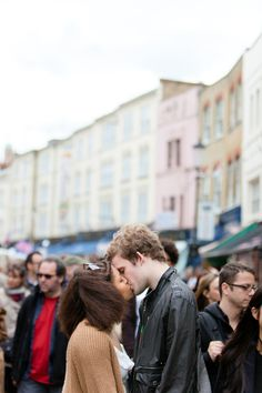 Jenna: I kinda like how they're in the middle of everything.  A kooky engagement shoot in Portobello Market, Notting Hill, London