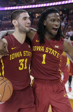 Iowa State's Georges Niang, left, and Jameel McKay, right, celebrate their win over Texas in an NCAA college basketball game, Saturday, Feb. 21, 2015, in Austin, Texas. Iowa State won 85-77. (AP Photo/Eric Gay)