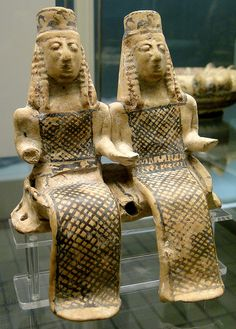 Terracotta model of 2 female figures, perhaps goddesses Demeter and Persephone, seated in a cart, Corinthian, Thebes?, c600 BC