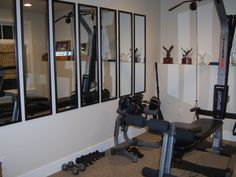 Our fitness room.  We wanted mirrors along one of the walls...but couldn't afford a solid wall of mirrors.  So we attached the inexpensive black framed mirrors to get a similar concept.  I think I like these better anyway.  Cost less than $50.