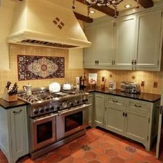Like the combination of delicate green cabinets and warm cream/yellowish walls with the Saltillo tile. Green Cabinets, White Kitchen Cabinets, Kitchen Tiles, Kitchen Flooring, New Kitchen, Oak Cabinets, Mexican Tile Kitchen, Glass Cabinets, Tile Flooring