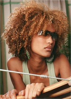 Awesome copper tones and rockin curly hair style!
