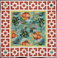 "Peacock Garden Art Quilt 05 ""The quilt has a center panel of peacock-print fabric surrounded by a narrow batik sash and pieced garden gate blocks. The print panel is accented with machine quilting, hand embroidery, beading and paillettes and sequins. The pieced blocks are also accented with leaf-shaped paillettes."""