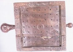 The Ballinderry Halatafl-Board (a board with peg-holes in it) for playing brandub, a variant of hnefatafl.