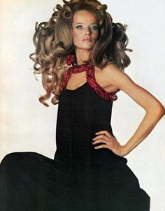 Veruschka in a Grès black velvet gown with red ruby like stone trim. Photo from Vogue 1967.