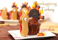 Thanksgiving-Turkey-Cupcakes. A very clever take on the Oreo, candy corn turkey idea.