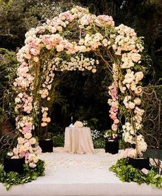 Floral archways can create a romantic, fairy tale look at an outdoor wedding | Rose petals available at Flyboy Naturals www.flyboynaturals.com