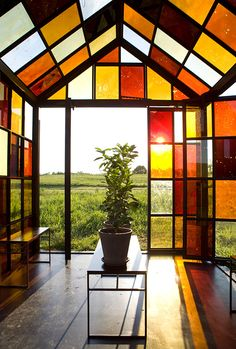 Artist William Lamson designed & built this 11x9 foot functional greenhouse, featuring 162 windows made out of caramelized sugar. For each of the window panes, Lamson cooked sugar at different temperatures to obtain the various colors. He then sealed the liquid between two panes of glass, enclosing the edges with silicone to prevent the window from absorbing water and leaking, and then installed each piece into the steel frame structure.