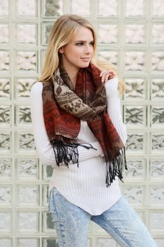 The perfect soft knit scarf to have for those cooler fall and winter months. A subtle print to give you a bit of color while you stay warm in style.