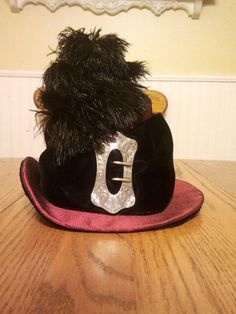 Wonderful feathered and buckled green velvet hat made by Christie V. in the online 1880s Hat class at HistoricalSewing.com