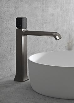 A magnificent bench mounted basin mixer adds a feeling of class and grandeur where a streamlined pin handled mixer contributes to the minimalist vibe.