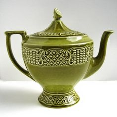 ITEM: Antique Canonsburg Tea Pot  CIRCA: 1968  DETAILS: Elegant, high quality, and fairly hard to come by stoneware teapot with corresponding lid.