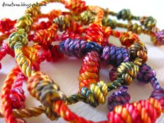 """#36 Infusion Rosary Twine. This rosary twine has been hand-dyed multiple times to create an infusion of colors in every single strand. Colors that range from subtle hues to """"wow"""" pops of multifaceted combinations! No two strands are alike!"""