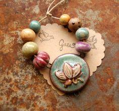 Gaea handmade ceramic design elements and adornments! | gaea  Ceramic Lotus Dream pendant and bead set.