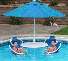 This looks good for a hot day - a couple of friends, cocktails.yes, this could work well! Umbrellas Parasols, Pool Furniture, Under My Umbrella, Getting Out, Party Time, Swimming Pools, Beach Mat, Outdoor Blanket, Lunch Time