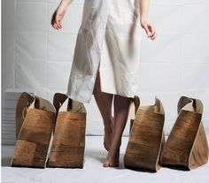 These eco tote bag upcycled PVC floor tiles that look like wood panels.
