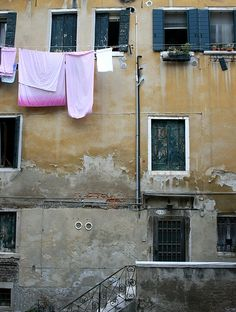 Venice - there is something nostalgic about laundry hanging out of windows for me...