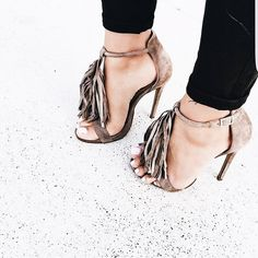 Light brown suede stiletto heels with fringe accent.