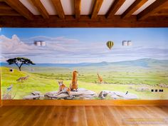 Safari Mural - Showing the right wall with a view looking down from up a hill, towards the Serengeti plains below, with cheetahs sitting on a rock, a jackal, giraffes, some birds and a hot air balloon