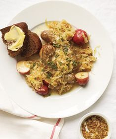 Slow-Cooker Sausages With Sauerkraut and Potatoes|With just 15 minutes of hands-on time, you can make a rib-sticking German meal of bratwurst, tender potatoes, and sauerkraut.