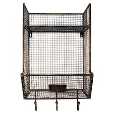 Stow balls of yarn or organize cookbooks in this wire mesh wall bin, featuring 3 hooks for hanging scarves and hats and an upper shelf for displaying knickkn...