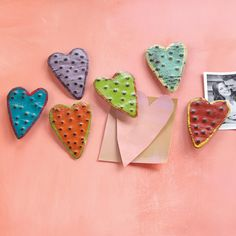 "HEART MAGNETS, SET OF 6 -- Keep all that's close at heart safe and close by with these handmade and handpainted metal magnets designed by Kathryn Arnett. Imported. Set of 6, each, 4""H."