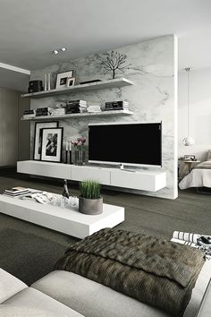 Luxury Apartment, marble wall divides living room from bedroom.