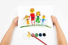 Child draws the family watercolors Royalty Free Stock Photo With coupon codes and promotional codes.