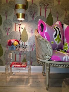 bright pillows and fun wallpaper
