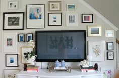 Frame a tv with eclectic art.. genius and beautiful!