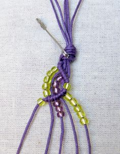 The site is ridden with advertisement, but it's worth visiting for the photographed tutorial on how to make this wave pattern macramé bracelet. The pattern calls for 5 cords that are 65cm each. Nothing about the bead size but an 8 or 6 aught would work just fine. One can use other types of beads too. They just have to work with each other in order to create a smooth curve.