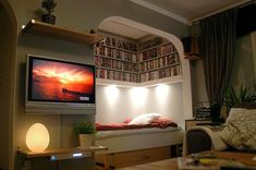 ...kind of awesome. I love movies. And I love nooks. Although I think I would replace the DVDs with books.
