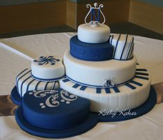 A lovely music themed cake by Kathy's Cakes; Put this in my wedding colors and it is AWESOME