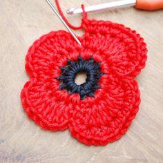here's a free Remembrance Poppy Crochet Pattern. Poppy Crochet, Crochet Poppy Free Pattern, Crochet Leaves, Crochet Flower Patterns, Cute Crochet, Crochet Motif, Crochet Stitches, Knitting Patterns, Knit Crochet