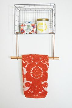 This creative wire basket towel rack is the perfect way to add more storage space to your bathroom.